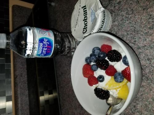 Plain Yogurt topped with Fresh berries and pineapple